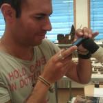 Patrik photographing through a microscope